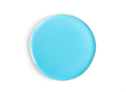 A round light blue glazed ceramic plate  dish  on a white backgr