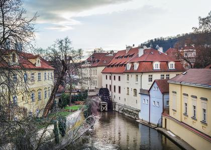 The old medieval mill wheel on Chertovka channel in Mala Strana
