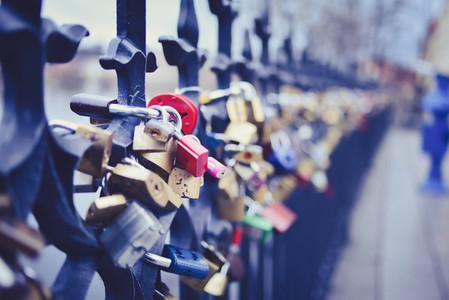 Locks of lovers on the fence on Staromestska side of Vltava near