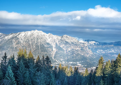 The view over the Bavarian Alpine slopes covered with snow from