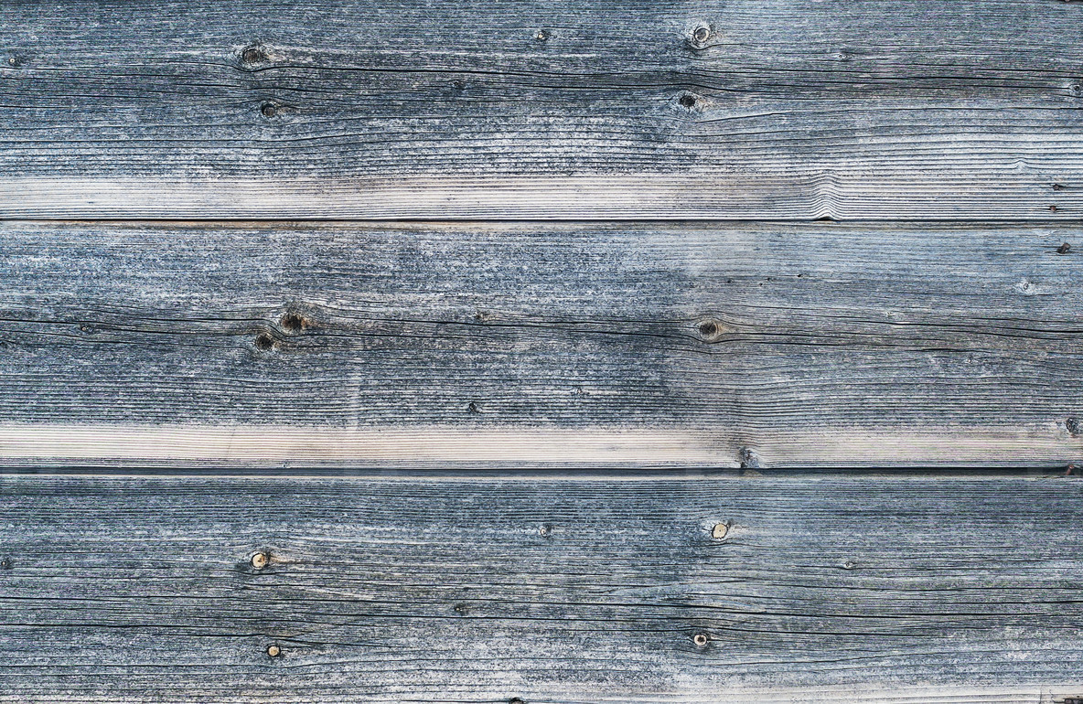 Old rough discolored wooden texture