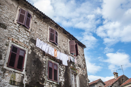 Common house of the old town of Kotor  Montenegro  with linen ha