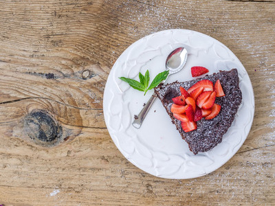 A piece of chocolate cake with fresh strawberry
