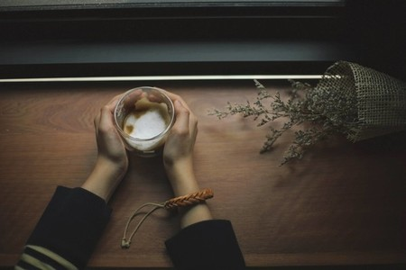 Female hands holding coffee