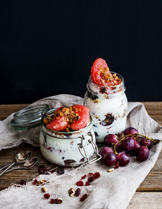Yogurt and oat granola with grapes  pomegranate  grapefruit in t