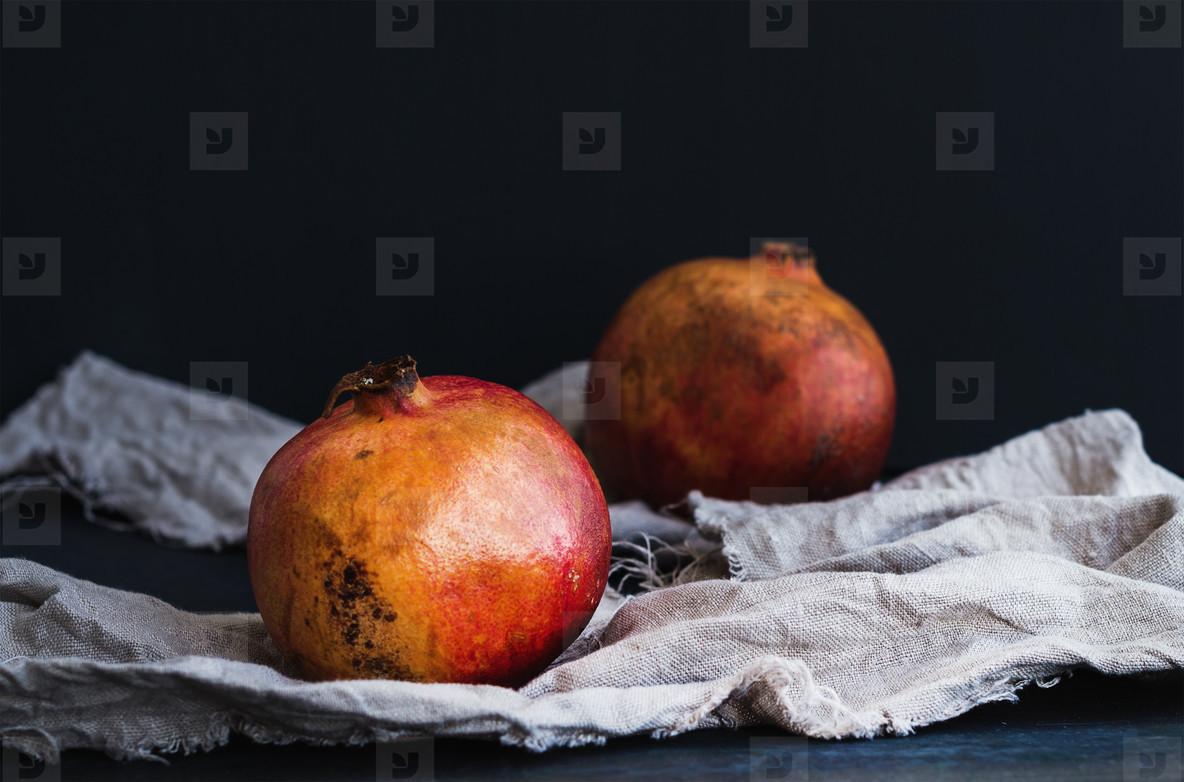 Red ripe pomegranate on dark background