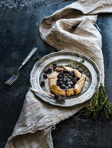 Homemade crusty pie or galette with blueberries