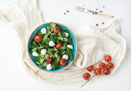 Spring salad with lamb s lettuce  mozzarella and cherry tomatoes