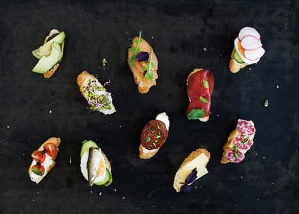 Mini sandwich set  Variety of small sandwiches on black backdrop