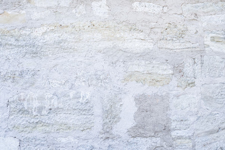 Old rough white stone wall texture