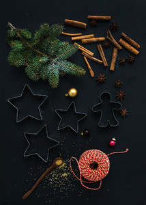 Baking ingredients for Christmas holiday traditional gingerbread cookies preparation  black background