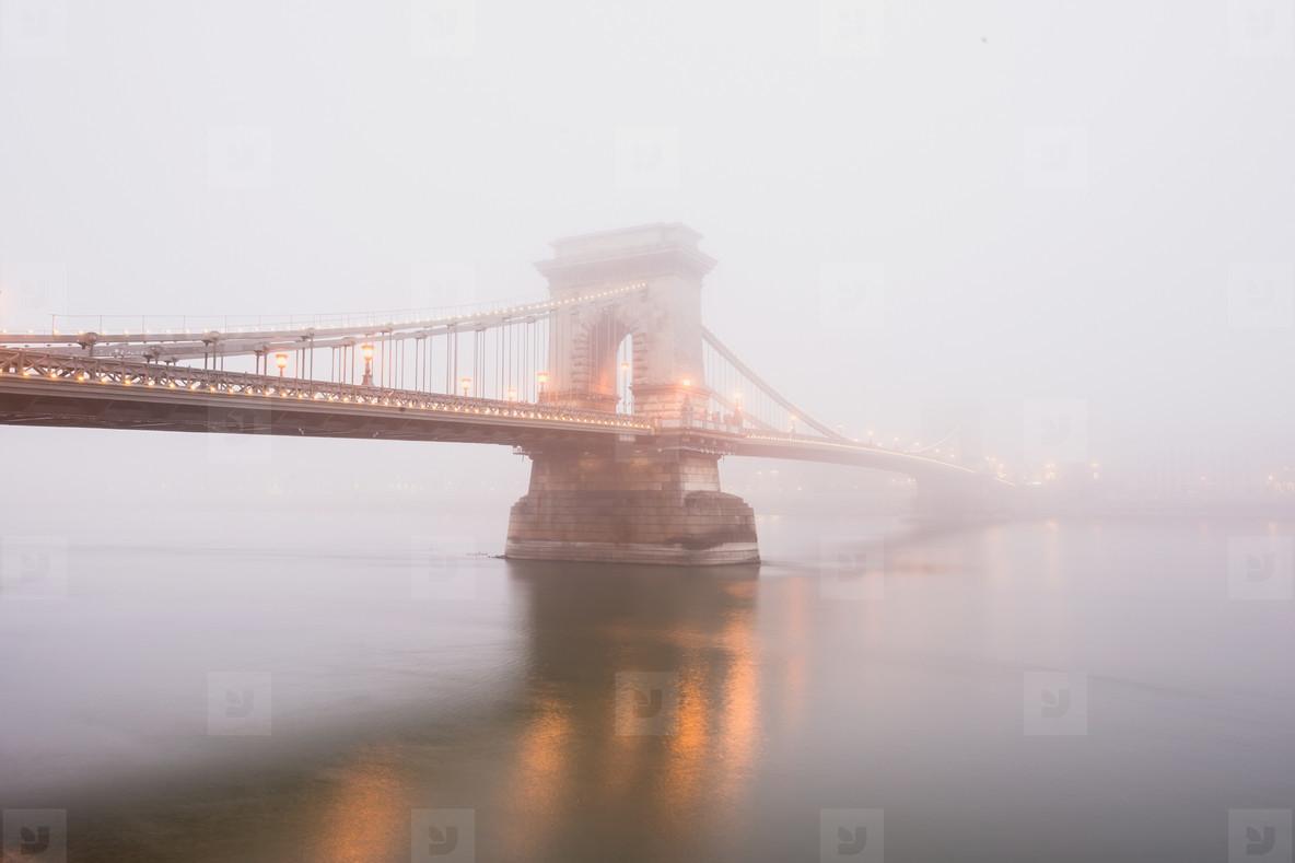 Chain Bridge in Budapest  Hungary  the fog  evening lights