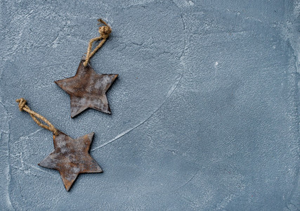 New year or Christmas background and texture  Toy rustic wooden stars over grunge grey surface  top view