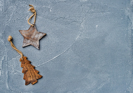 New year or Christmas background  Toy rustic wooden star and fur tree over grunge grey surface  top view