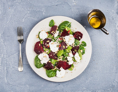 Salad with roasted beetroot  spinach  soft goat cheese and seeds