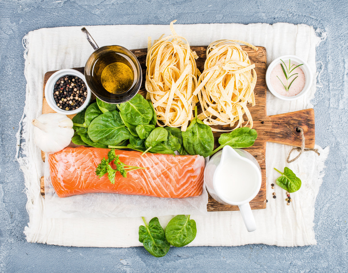 Ingredients for cooking pasta tagliatelle with salmon  spinach and cream