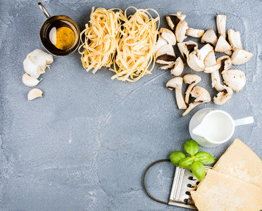 Ingredients for cooking pasta with mushrooms and white sauce