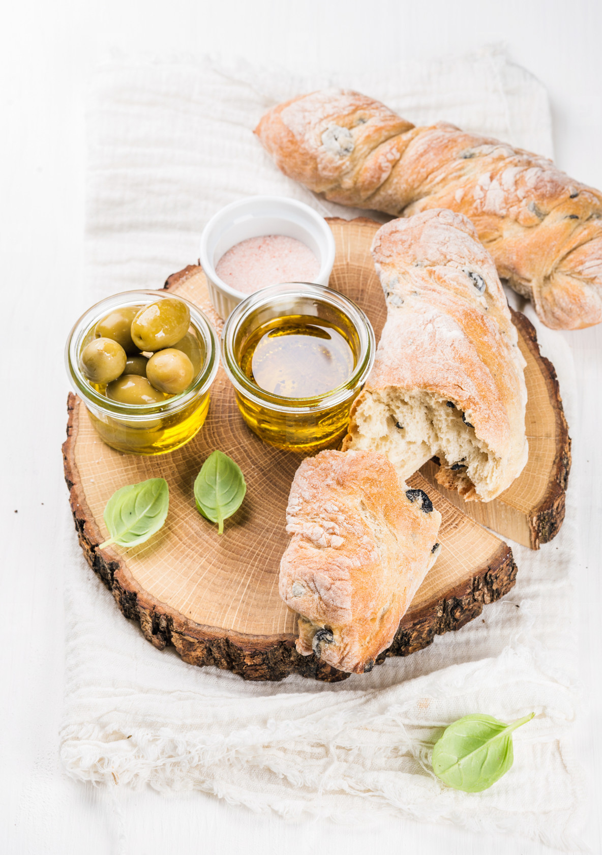 Fresh ciabatta bread  Mediterranean olives and fresh vrgine oil with basil