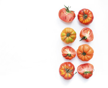 Selection of heirloom tomatoes on a white backdrop