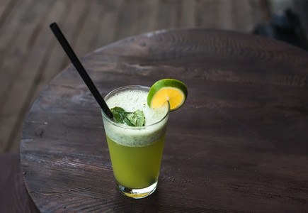 Fresh homemade lemonade with mint on dark wooden table in cafe