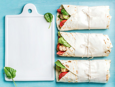 Healthy lunch snack  Tortilla wraps with grilled chicken fillet and fresh vegetables
