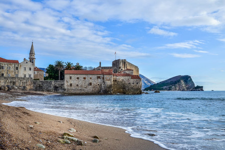 Montenegro  Budva beach near old town wall and fortress in winte