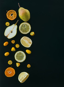 Fresh fruit andcitrus mix on black pieces of pear  mandarin  gr