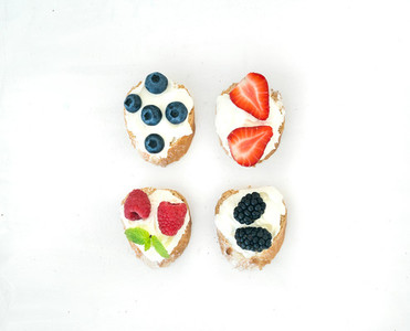Set of small sweet sandwiches with cream cheese and fresh forest