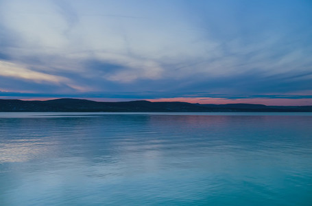 Evening view of the lake and mountains at sunset  blue hour  Balaton  Hungary