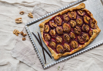 Rustic plum pie with walnuts and vanilla