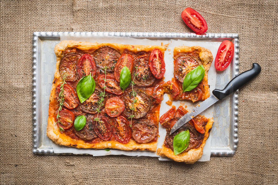 Tomato cake with fresh basil and thyme and selection of fresh to