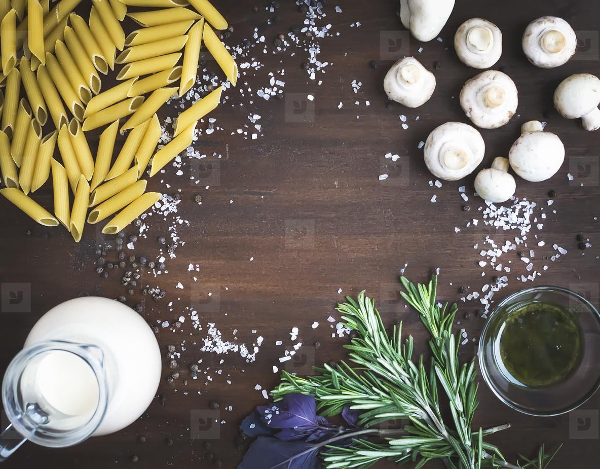 Mushroom pasta ingredients  penne  mushrooms  a jug of cream  pe