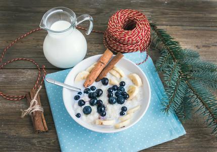 Rice porridge with milk  cinamon  banana and blueberry with Chri
