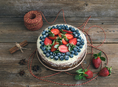 Rustic spicy ginger cake with cream cheese filling fresh strawb