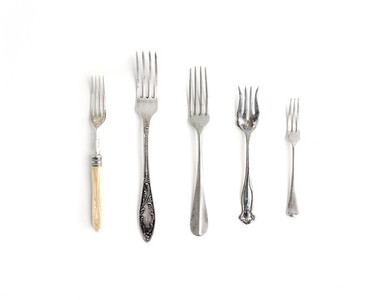 A set of vintage dinnerware  forks of different shapes and sizes
