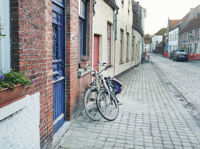 Medieval empty side street of Bruges  Belgium  with a bike parke
