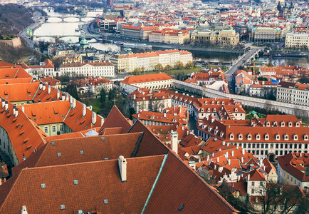 The view over the red roofs of Prague from the tower of the aint