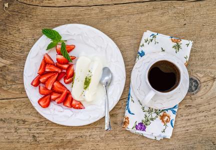 Goat milk ice cream with pistachio and strawberry