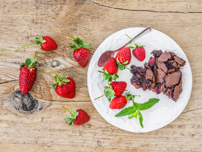 A piece of chocolate strawberry cake with fresh strawberries and
