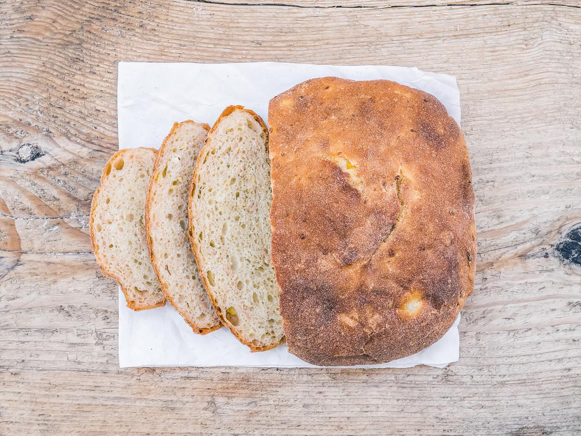 A half of home made village potato bread
