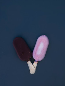 Two small ice creams on the dark