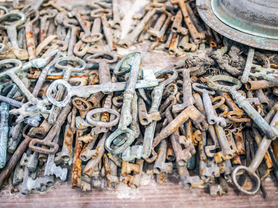 Antique rusty metal keys on a market stall at a flee market