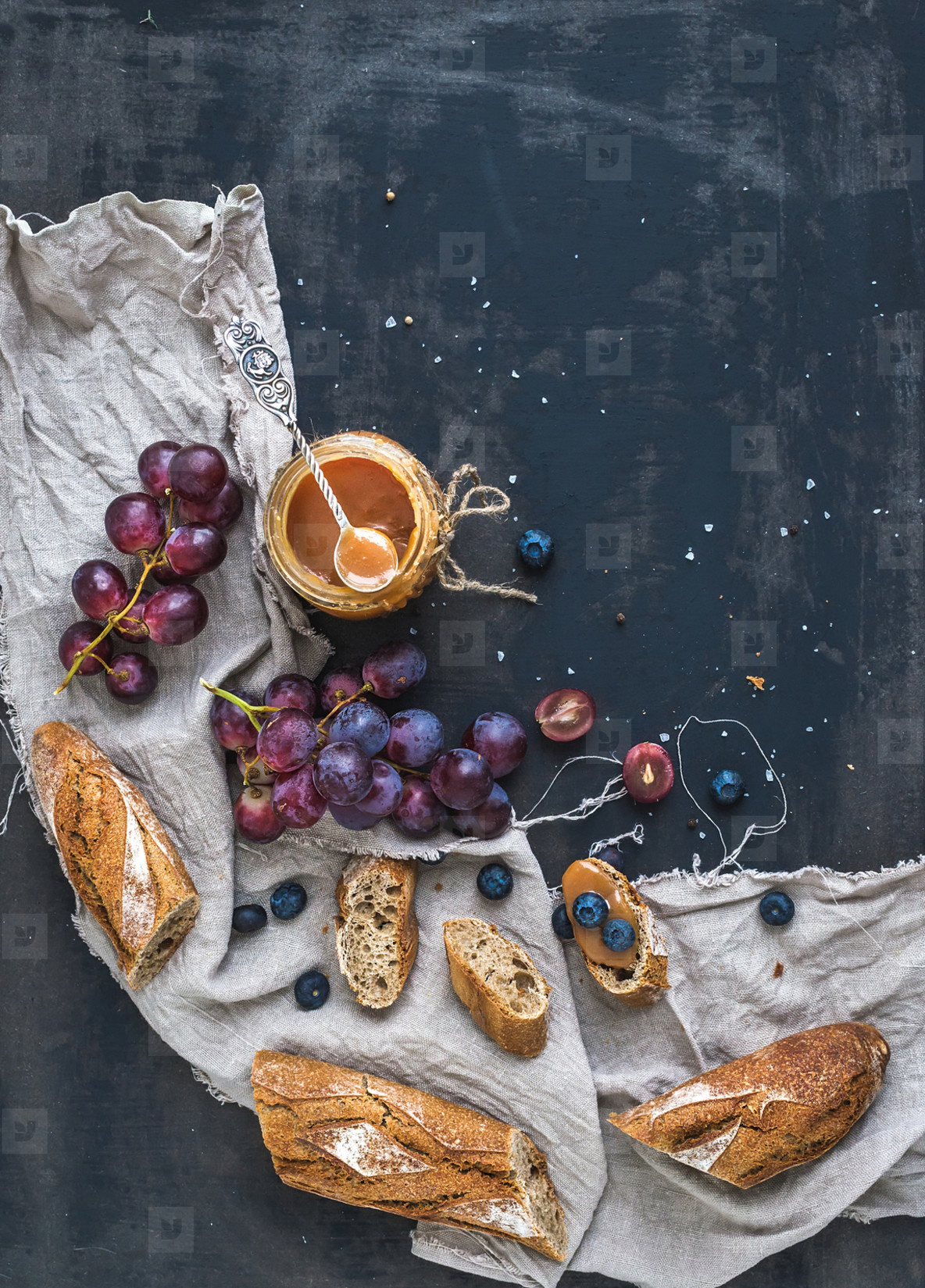 French baguette cut into pieces  red grapes  blueberry and salt caramel sauce