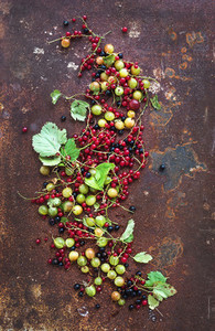 Summer berries on rusty grunge metal background  top view