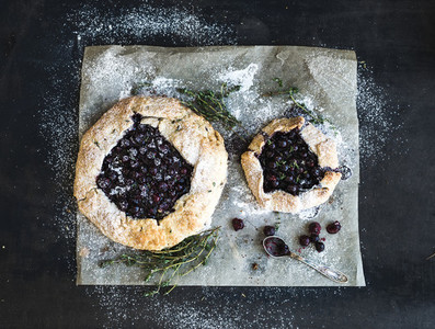 Homemade crusty blueberry pie or galette with ice cream