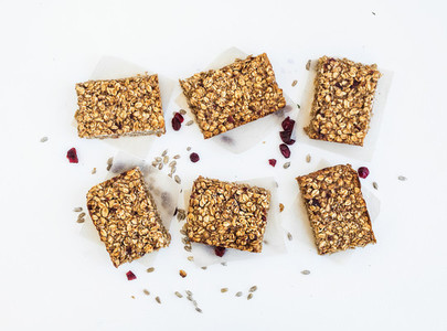 Granola bars on white background top view