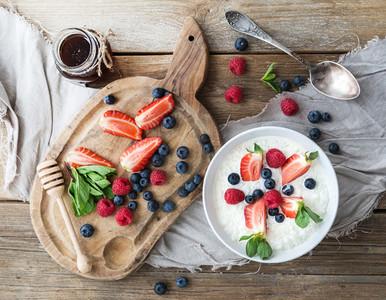 Healthy breakfast set  Rice cereal or porridge with berries and honey