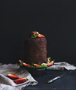 Chocolate high cake with strawberry  dark background