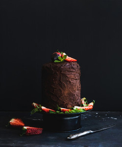 Chocolate high cake with strawberry  dark background