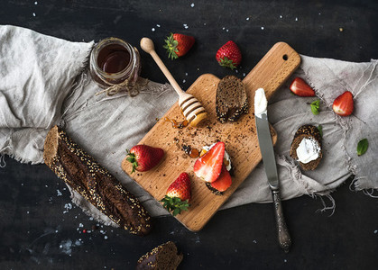 Breakfast set Black baguette toasts with fresh strawberries honey and mascarpone cheese